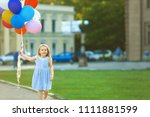 little girl with colorful... | Shutterstock . vector #1111881599
