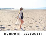 beautiful young woman in straw... | Shutterstock . vector #1111883654