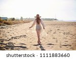 beautiful young woman in straw... | Shutterstock . vector #1111883660