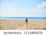 beautiful young woman in straw... | Shutterstock . vector #1111883678
