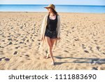 beautiful young woman in straw... | Shutterstock . vector #1111883690