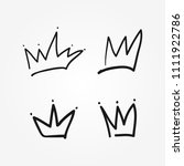 set of isolated crowns drawn by ... | Shutterstock .eps vector #1111922786