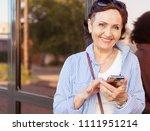 mature attractive stylish woman ... | Shutterstock . vector #1111951214