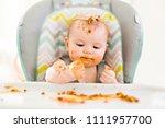 little baby eating her dinner... | Shutterstock . vector #1111957700