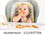 little baby eating her dinner... | Shutterstock . vector #1111957706