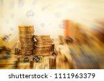 stacks of golden coins on... | Shutterstock . vector #1111963379