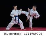 children are training karate... | Shutterstock . vector #1111969706