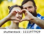 couple in love gesturing heart... | Shutterstock . vector #1111977929