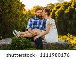 happy romantic couple sits in... | Shutterstock . vector #1111980176