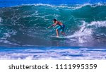 riding the waves. costa rica ... | Shutterstock . vector #1111995359