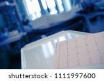 ecg chart on the desktor in the ...   Shutterstock . vector #1111997600