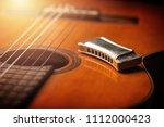 Vintage wooden harmonica lying...