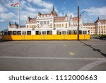 parliamen tbuilding with yellow ... | Shutterstock . vector #1112000663