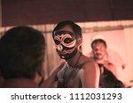kathakali artist with black... | Shutterstock . vector #1112031293