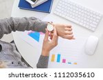young businesswoman checking...   Shutterstock . vector #1112035610