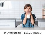 cute little girl drinking milk... | Shutterstock . vector #1112040080