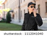 male security guard using... | Shutterstock . vector #1112041040