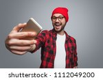 handsome young hipster in red... | Shutterstock . vector #1112049200