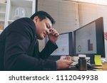 stressed businessman having... | Shutterstock . vector #1112049938