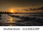 a coastal sunrise with waves...