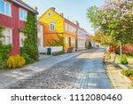 Trondheim, Norway, 05/29/2018 : Bakklandet , old neighbourhood in Trondheim, with small wooden houses and narrow streets. it is among the major tourist attractions in the city.