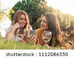 beautiful women using mobile in ... | Shutterstock . vector #1112086550