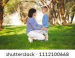little funny boy with mother   Shutterstock . vector #1112100668
