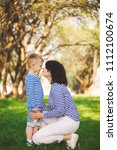 little funny boy with mother   Shutterstock . vector #1112100674