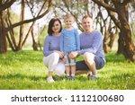 happy family in summer park   Shutterstock . vector #1112100680