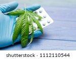 marijuana and pills. leaf of... | Shutterstock . vector #1112110544