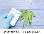 marijuana and pills. leaf of... | Shutterstock . vector #1112110664