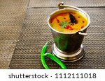 north india food tadka dal in... | Shutterstock . vector #1112111018