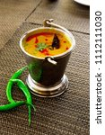 north india food tadka dal in... | Shutterstock . vector #1112111030