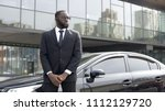confident afro american driver... | Shutterstock . vector #1112129720