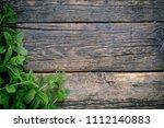 bunch of fresh green mint on... | Shutterstock . vector #1112140883