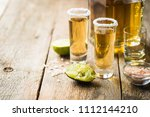 mexican gold tequila shots with ... | Shutterstock . vector #1112144210