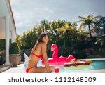 happy woman in bikini relaxing... | Shutterstock . vector #1112148509