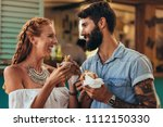 portrait of happy young couple... | Shutterstock . vector #1112150330