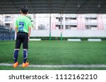 asian young boy waiting to come ... | Shutterstock . vector #1112162210
