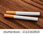 cigarettes close up on a wooden ...   Shutterstock . vector #1112162810