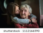 A little girl hugs her...