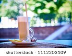 a coffee drink in a glass on a... | Shutterstock . vector #1112203109