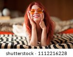pretty young woman with red... | Shutterstock . vector #1112216228
