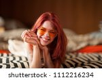 pretty young woman with red... | Shutterstock . vector #1112216234