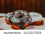 chocolate and vanilla donuts | Shutterstock . vector #1112217023
