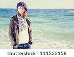 Fashion young women at the beach in sunny day. - stock photo