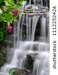 small waterfall in the garden. | Shutterstock . vector #1112252426