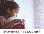 sad asian little child girl... | Shutterstock . vector #1112274854