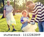 kids picking up trash in the... | Shutterstock . vector #1112282849