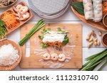 cooking vietnamese summer roll | Shutterstock . vector #1112310740